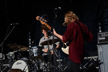 two guys playing in a band